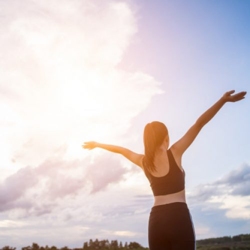 happy-smiling-athletic-woman-with-arms-outstretched_1150-4184
